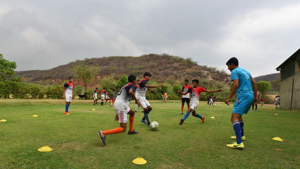 "The village's cricket ground was converted into a football field. ""We got our initial training from YouTube,"" says Yashvir, 18. And two years back, players from the village also formed a club — M2M football club — with its own logo and jerseys. (Raj K Raj / HT Photo)"