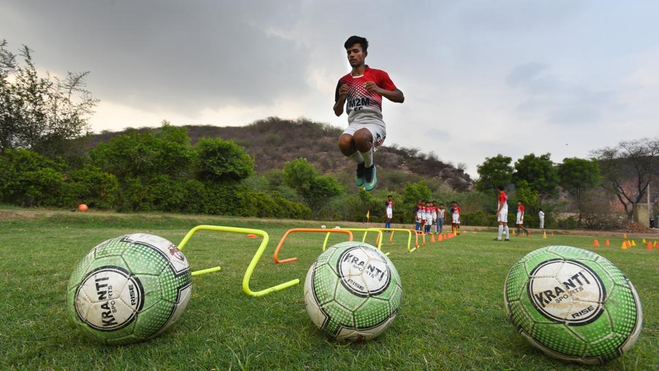 "In 2016, impressed by the village's passion for football, the Delhi United football club decided to train Ghamroj's footballers and plans to make it 'a model football village'. ""Their footballers have great talent. Our club wishes to set up a residential academy to help develop football in the area,"" said Krishan Kumar Ekka, head coach, Delhi United Football Club's football academy. (Raj K Raj / HT Photo)"