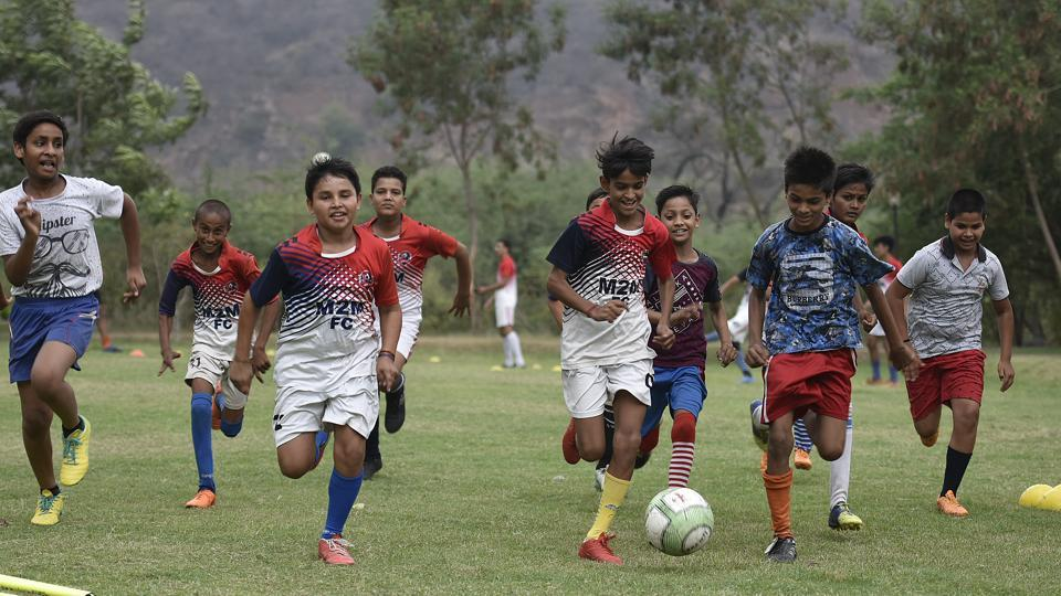 It's been four years at Haryana's Ghamroj village since its young cricketers switched allegiances to football. Coach Mahesh Raghav recalls how none of his 50 trainees turned up one cloudy evening in June 2014 –around the time of the FIFA World Cup –a first in his 10 years of coaching the village's players, and a turning point in both their lives.  (Raj K Raj / HT Photo)