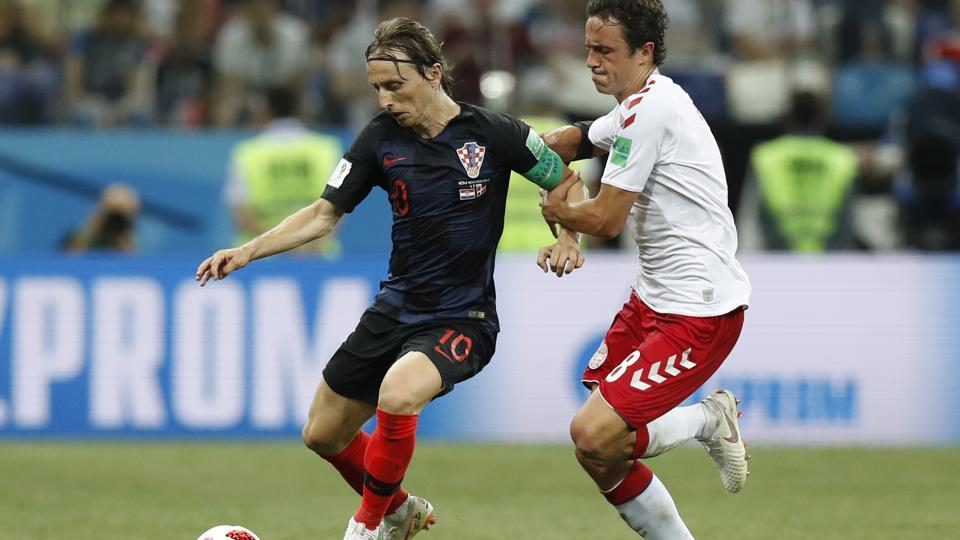 Croatia's Luka Modric, left, and Denmark's Thomas Delaney challenge for the ball during the round of 16 match. (AP)
