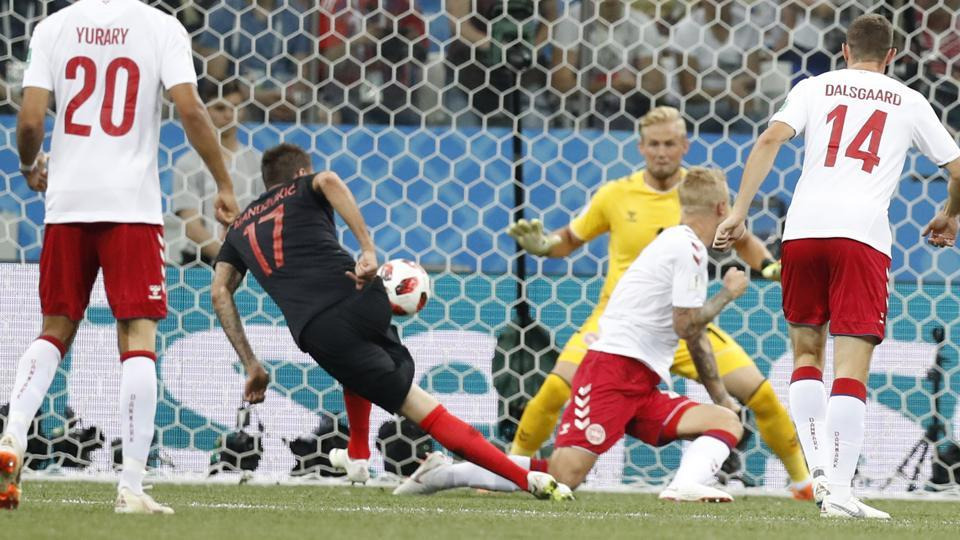 Croatia's Mario Mandzukic, second from left, scores his side's first goal during the round of 16 match. (AP)