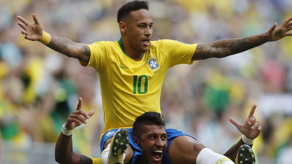 Brazil's Neymar, top, celebrates with team mate Paulinho after scoring his side's opening goal. (AP)