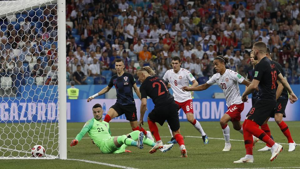 Croatia goalkeeper Danijel Subasic, left on the pitch, looks at the ball after Denmark's Mathias Jorgensen scored the opening goal. (AP)