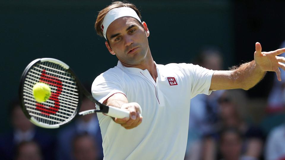 Switzerland's Roger Federer in action during the first round match against Serbia's Dusan Lajovic.