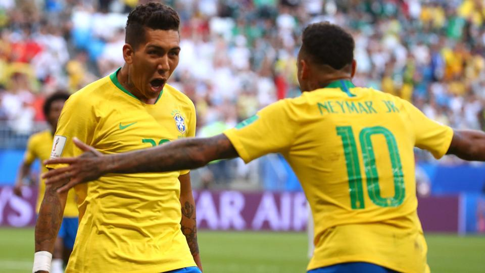 Brazil's Roberto Firmino celebrates scoring their second goal with Neymar. (REUTERS)