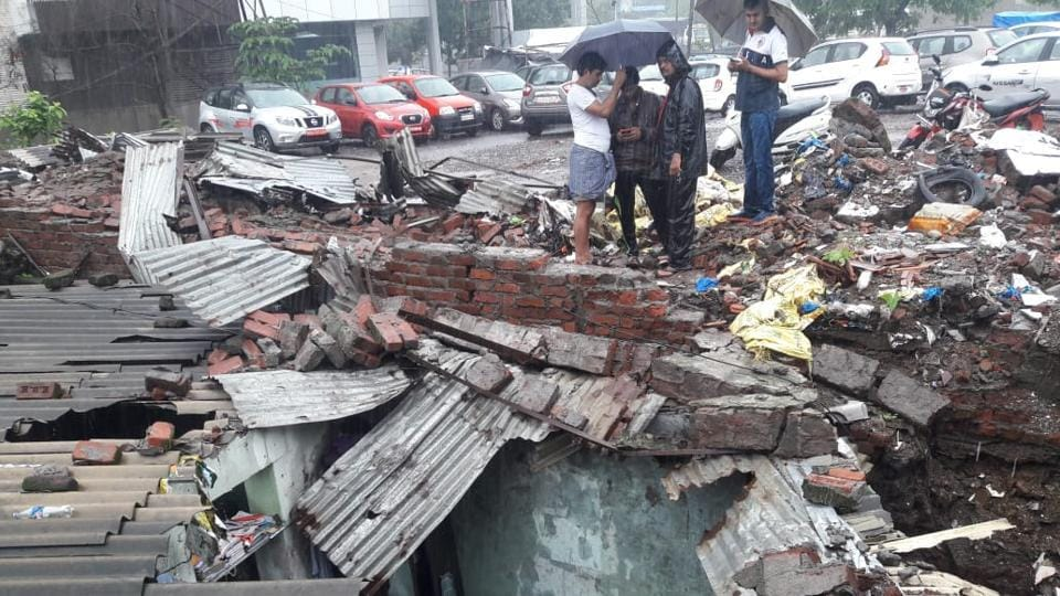 One person died as a wall collapsed during the rains at Patlipada GB road, Thane. Heavy overnight rains and waterlogging in many areas are suspected to be the cause of these crashes. (Praful Gangurde / HT Photo)