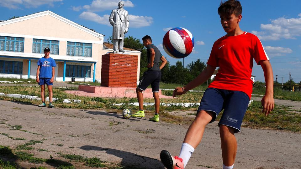 Dimitri Strazhkov dreams about becoming a professional player with CSKA Moscow and one day being called up to play for Russia's national team. The 15 year-old and other boys of all ages train every day at a small soccer field in the village of Aleksandrovka that was built only five years ago as a present from the town of Samara. (David Gray / REUTERS)