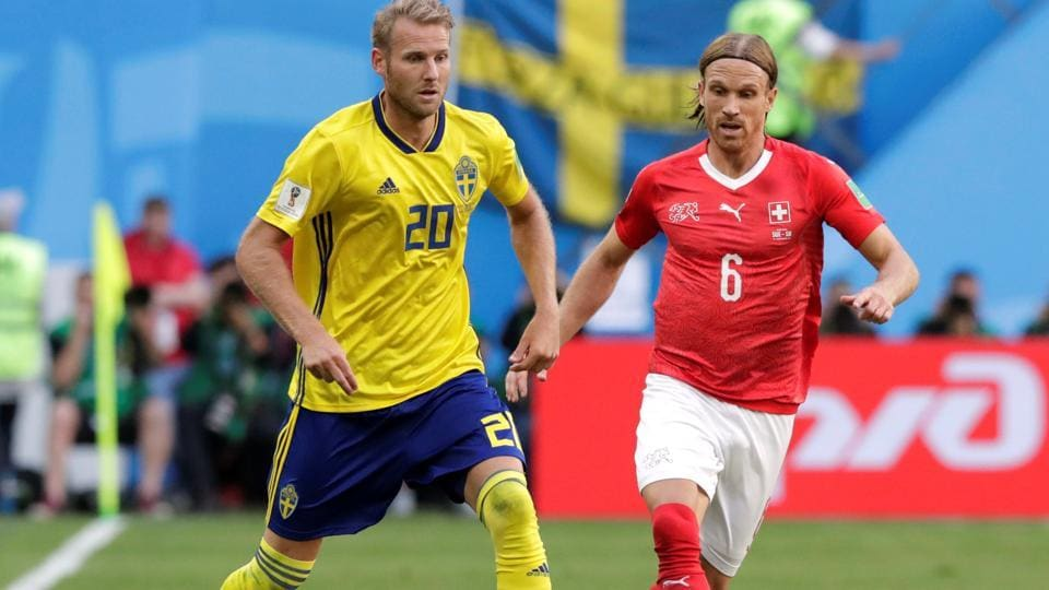 Sweden's Ola Toivonen in action with Switzerland's Michael Lang. (REUTERS)
