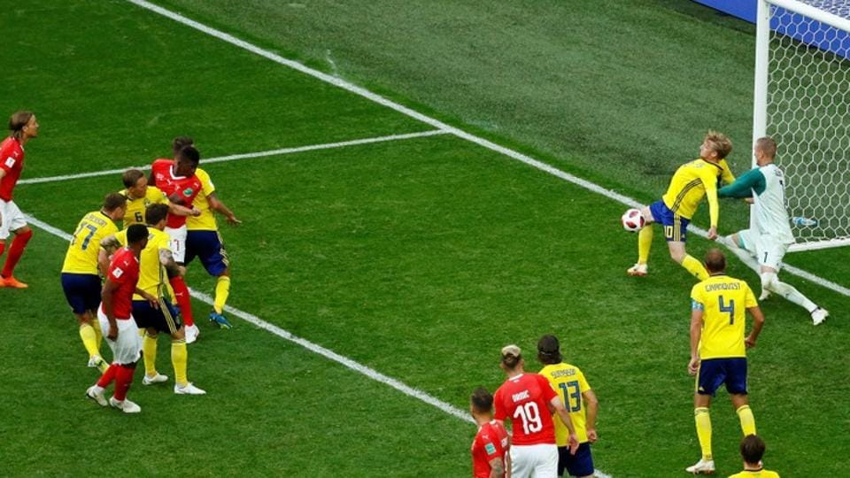Sweden's Emil Forsberg blocks a shot on the line from Switzerland's Breel Embolo (REUTERS)