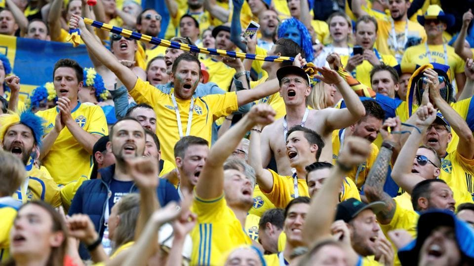 Sweden fans celebrate victory after the match. (REUTERS)