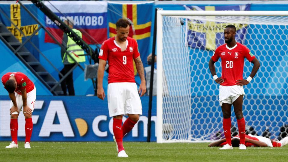 Switzerland players look dejected after the match. (REUTERS)