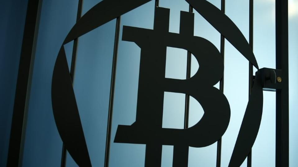 FILE PHOTO: A Bitcoin (virtual currency) logo is pictured on a door in an illustration picture taken at La Maison du Bitcoin in Paris May 27, 2015. REUTERS/Benoit Tessier