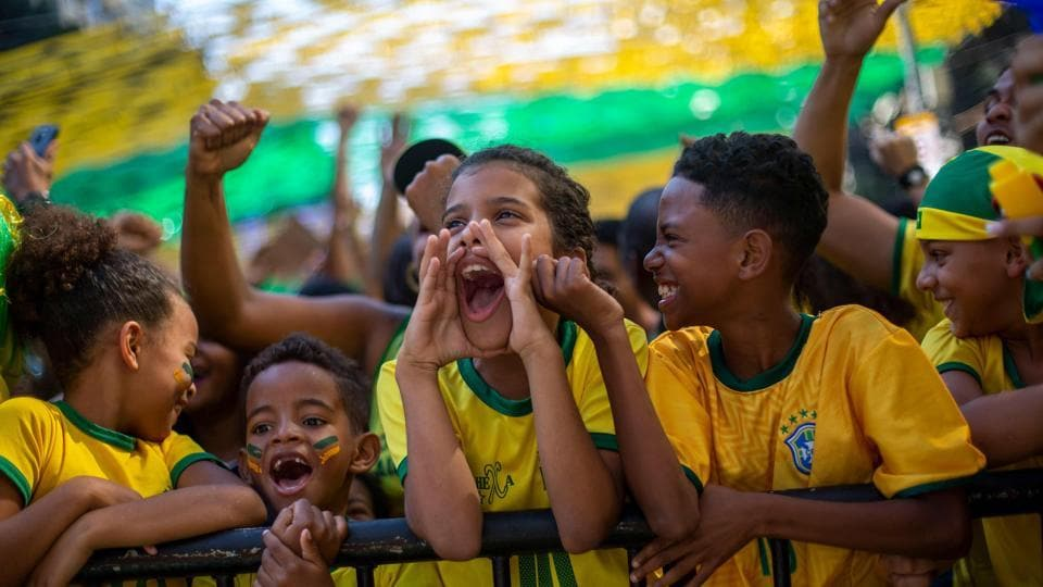 Fans of Brazil watch the World Cup match between Brazil and Mexico on a big screen set on Alzira Brandao street in northern Rio de Janeiro. (AFP)