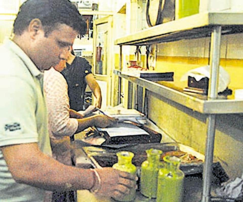 Food safety team collecting samples during a raid at Chandigarh Golf Club.