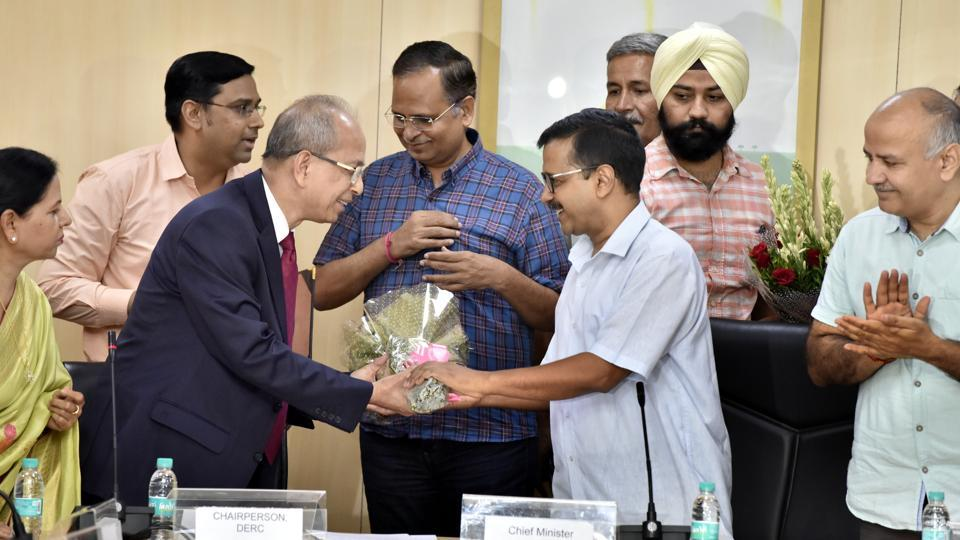 Delhi Chief Minister, Arvind Kejriwal greets justice (retired) Satyendra Singh Chauhan during his oath taking ceremony as the Delhi Electricity Regulatory Commission chairperson at Delhi Secretariat, in the presence of deputy chief minister Manish Sisodia, power minister Satyendar Jain and others. (Sonu Mehta / HT Photo)