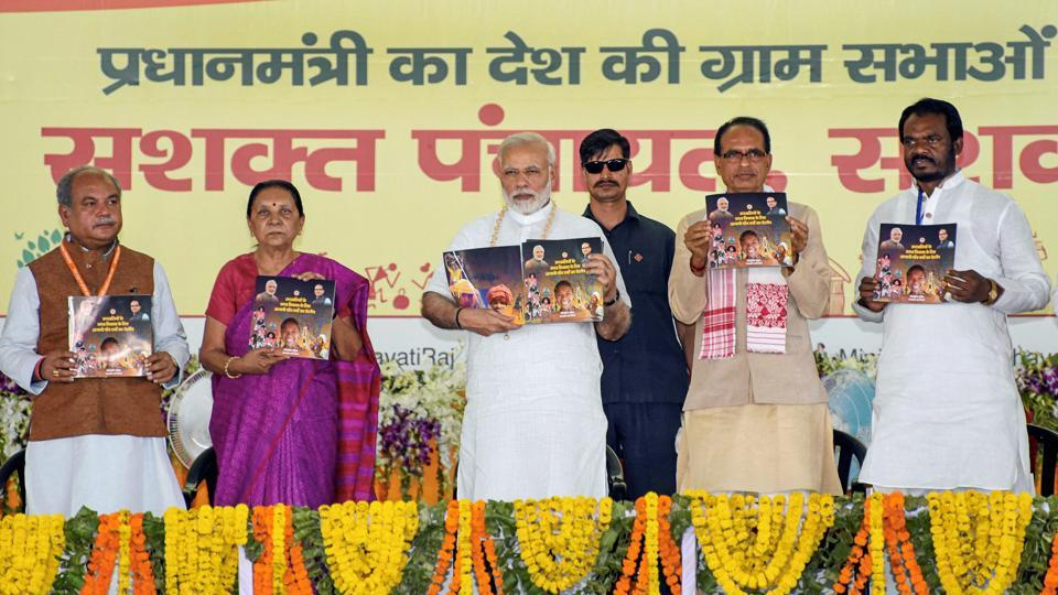 Prime Minister Narendra Modi and Madhya Pradesh chief minister Shivraj Singh Chouhan during a book release on the occasion of the National Panchayati Raj Day 2018, Mandla, Madhya Pradesh. In Panchayati Raj, decisions are taken at the grassroots and they are scaled up to the district level.