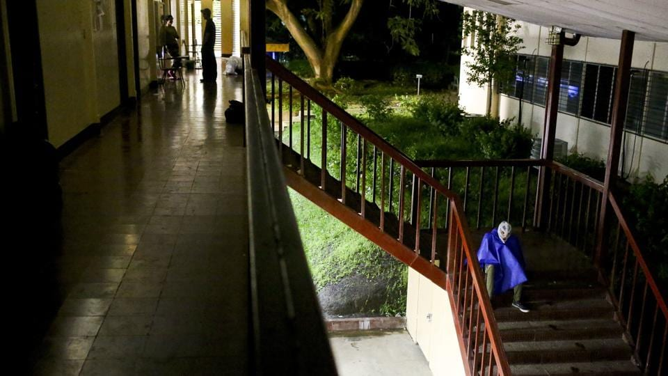 A masked student rests on a stairwell. The students holed up here have masked their identities for protection. The government dismisses them as delinquents and says police have to respond when students disrupt traffic. (Esteban Felix / AP)
