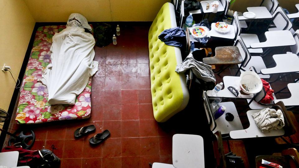 A university student sleeps inside a classroom at the Autonomous University of Nicaragua. Human rights organizations have tallied at least 250 deaths — the majority of them demonstrators but also some bystanders — since street protests began in mid-April in the capital and other cities across Nicaragua. (Esteban Felix / AP)