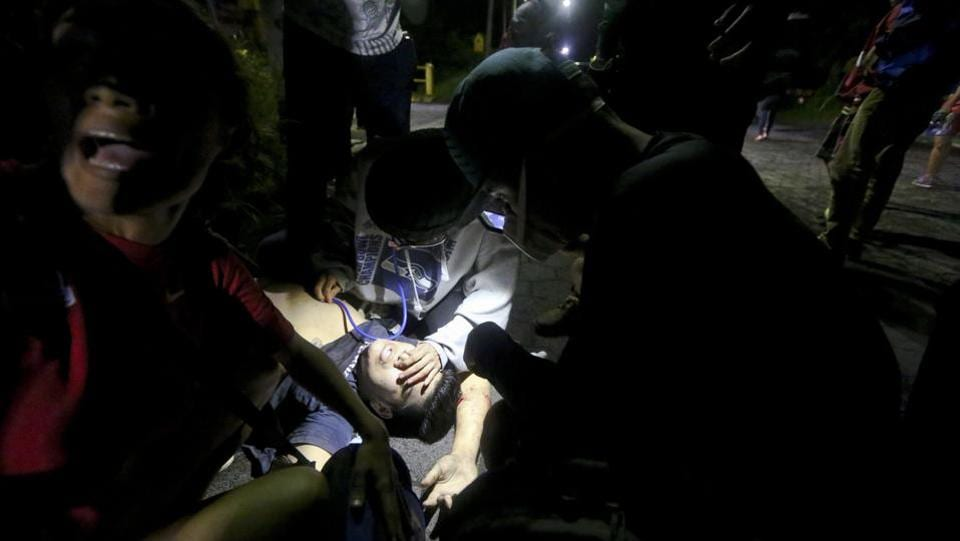 Such measures are meant to fend off raids like one on June 7 when armed pro-government youths rushed the building. Shots rang out and students ran to a barricade where they found 19-year-old Chester Chavarria wounded by gunfire. (Esteban Felix / AP)