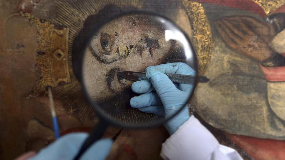 An art restorer works on a 17th century painting in a studio at the Ministry of Culture's Restoration Centre in Cuzco, Peru. Sculptures of decapitated Roman Catholic saints, dismembered angels and charred paintings from remote churches across the spine of the Andes -- all find their way here, where a team of dedicated specialists mends them after centuries of neglect. (Martin Mejia / AP)