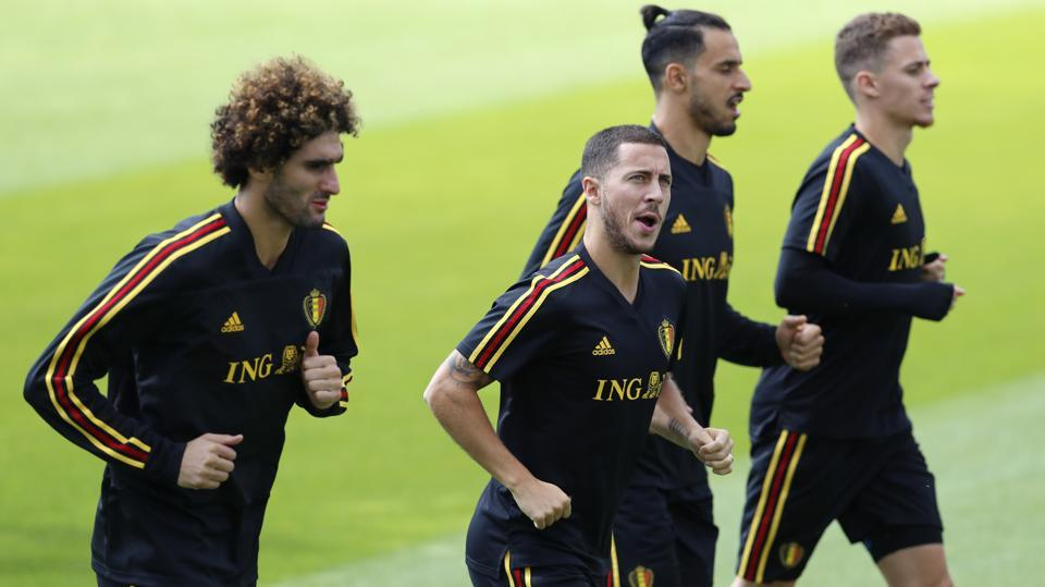 Belgium's Marouane Fellaini(L), Eden Hazard (2ndL), Nacer Chadli(2nd R) and Thorgan Hazard warm up during a session ahead of their FIFAWorld Cup quarterfinal against Brazil at the Kazan Arena on Friday. (AP)