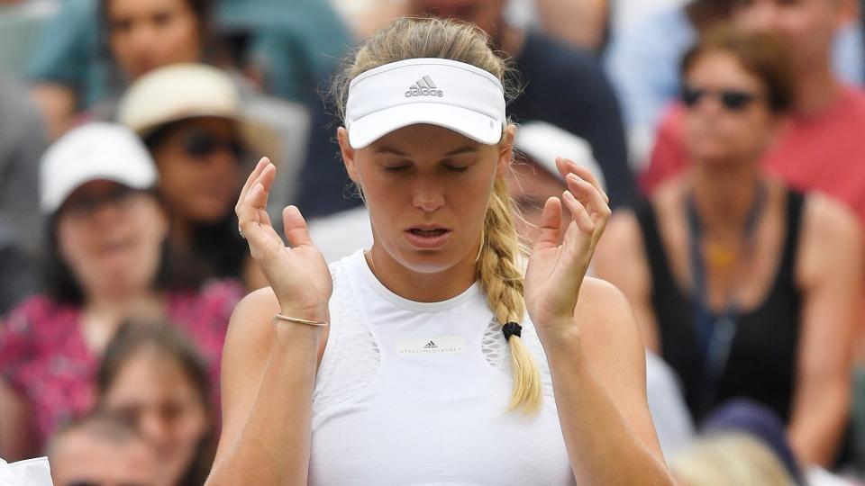 Denmark's Caroline Wozniacki reacts after loosing her Wimbledon second round match against Russia's Ekaterina Makarova. (REUTERS)