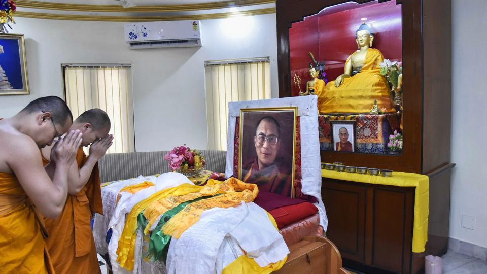 Buddhist monks from Thailand offer prayers on the 83rd birthday of 14th Dalai Lama Tenzin Gyatso, at Bodh Gaya on Friday. Born on July 6, 1935, in northeastern Tibet, the Dalai Lama was recognised at the age of two as the reincarnation of the 13th Dalai Lama, Thubten Gyatso. (PTI)