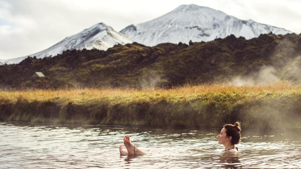 A hot spring in Landmannalaugar, Iceland.  Hot springs are the perfect place to unwind and get relief from a busy lifestyle.