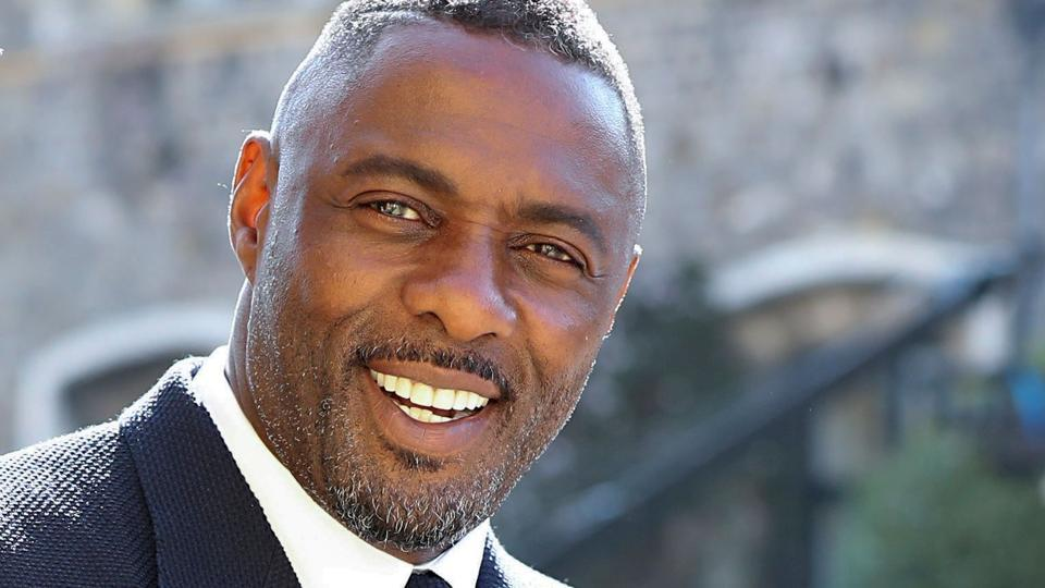 British actor Idris Elba arrives for the wedding ceremony of Britain's Prince Harry, Duke of Sussex and US actress Meghan Markle at St George's Chapel, Windsor Castle.