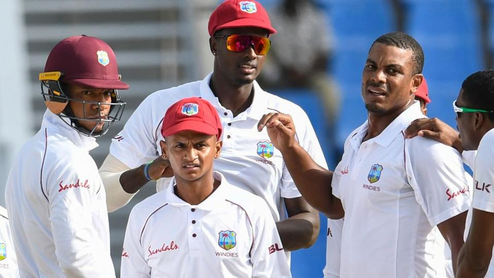 Kieran Powell (from left), Shane Dowrich, Jason Holder and Shannon Gabrielof West Indies celebrate the dismissal of Mominul Haque of Bangladesh during day 2 of the 1st Test at Sir Vivian Richards Cricket Ground, North Sound.