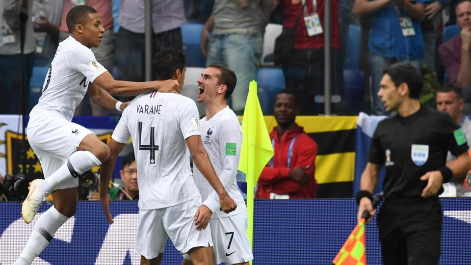 Raphael Varane (2nd L) celebrates with Antoine Griezmann (2ndR) and Kylian Mbappe after scoring the opener for France during the FIFAWorld Cup 2018 quarterfinal against Uruguay.
