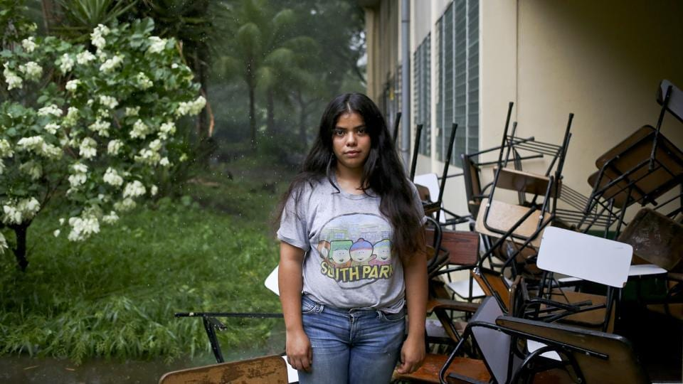 Students like Valeska Sandoval have barricaded themselves inside their school, stacking desks to limit access points to buildings. They say it's the only place they feel safe and they've been joined by students from other schools. (Esteban Felix / AP)