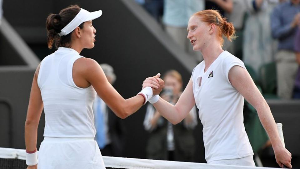 Belgium's Alison Van Uytvanck shakes hands with Spain's Garbine Muguruza after winning her Wimbledon second round match.