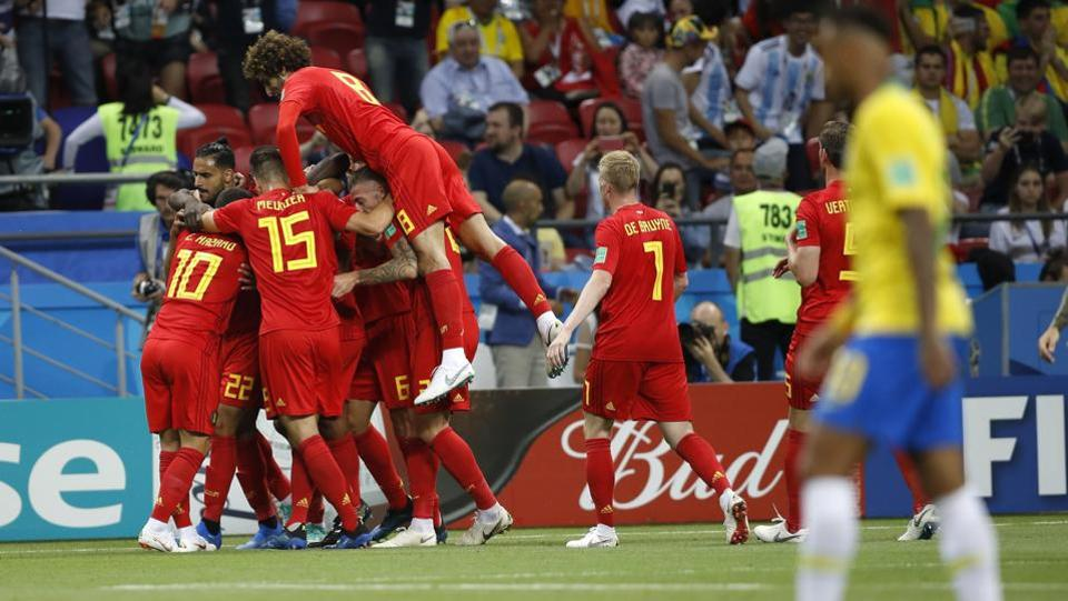 Belgium players celebrate after taking the early lead in Kazan. (AP)
