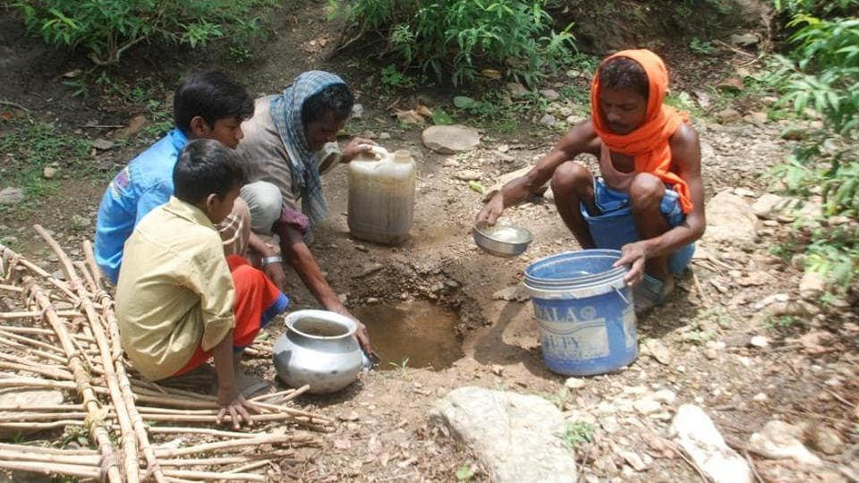 Residents of Uttar Pradesh's Sonbhadra dig small pits in the foothill of dried waterways in search of potable water.