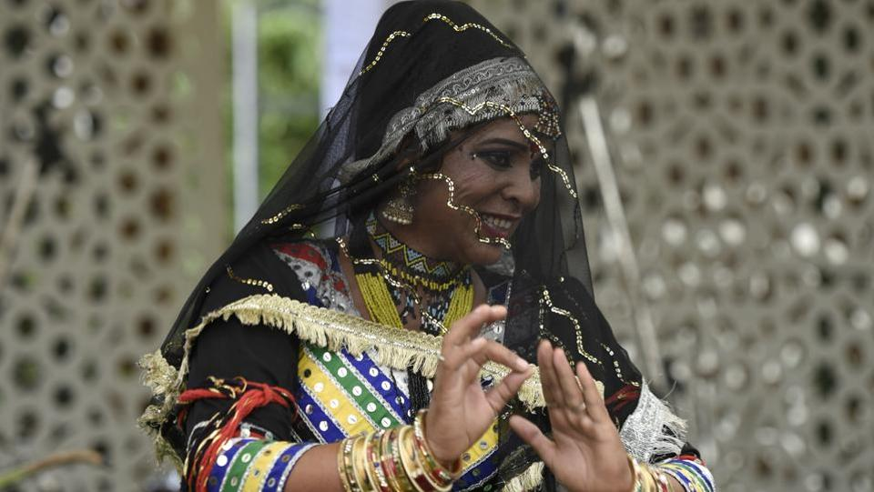 A participant performs a folk dance at the festival. (Burhaan Kinu / HT Photo)