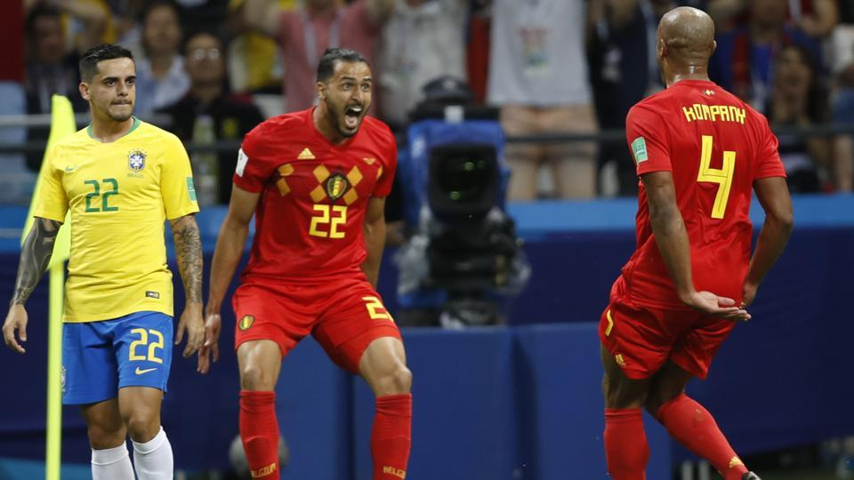 Brazil's Fagner, left, looks on as Belgium's Nacer Chadli and Vincent Kompany, right, celebrate their first goal. (AP)