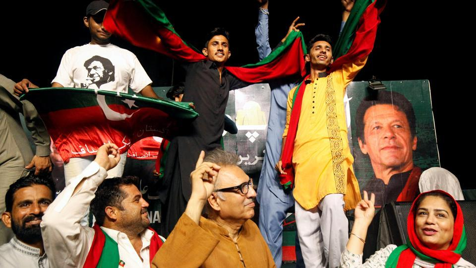 Supporters of Imran Khan, chairman of the Pakistan Tehreek-e-Insaf (PTI) political party, dance to celebrate the verdict of accountability court on an anti-corruption case against ousted Prime Minister Nawaz Sharif and his daughter, on a campaign truck in Karachi, Pakistan on July 6.