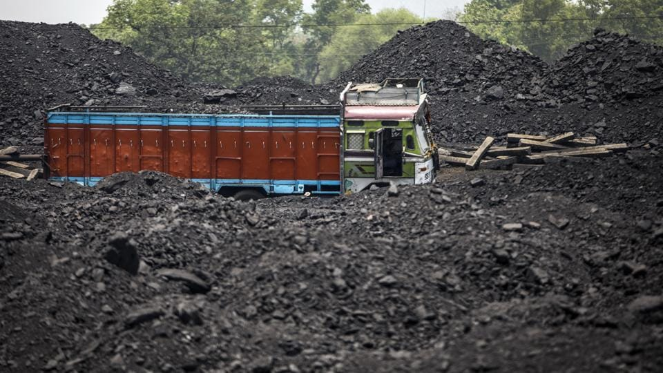 A truck sits parked next to piles of coal at the Tori Siding. A lack of proper extraction methods, land disputes and Naxal fears had first delayed and then hindered production at the Amrapali and Magadh open cast mines. The two mines were touted as giant leaps in Jharkhand's power generation and job creation efforts. (Prashanth Vishwanathan / Bloomberg)