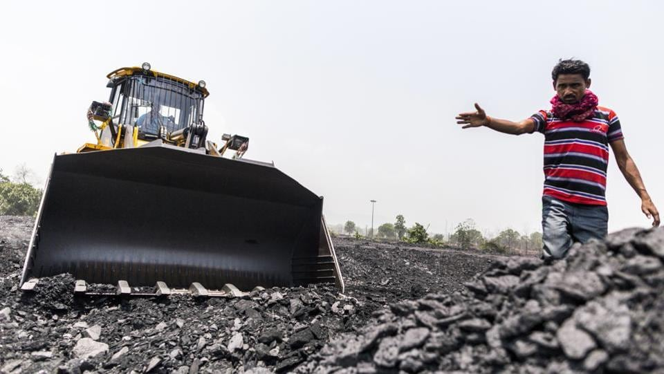 A man directs a front loader at the Tori Siding. The addition of the two mines is expected to add another 47 million tonne peak production capacity to CCL's output, which stood at 67.6 million tonnes for financial year 2017-18. (Prashanth Vishwanathan / Bloomberg)