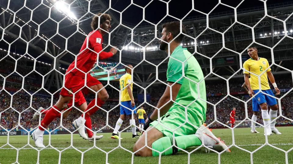 Brazil's Alisson looks dejected after conceding the first goal as Belgium's Marouane Fellaini celebrates. (REUTERS)