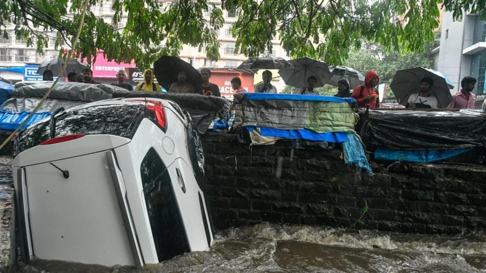 A car that was washed away during heavy rains in Andheri, Mumbai on Sunday. (Shashi S Kashyap/HT Photo)