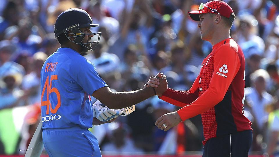 India's Rohit Sharma, left, shakes hands with England's Jason Roy after securing the victory. (AP)