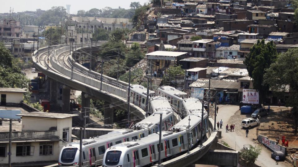 A Mumbai metro train runs at Ghatkopar in Mumbai