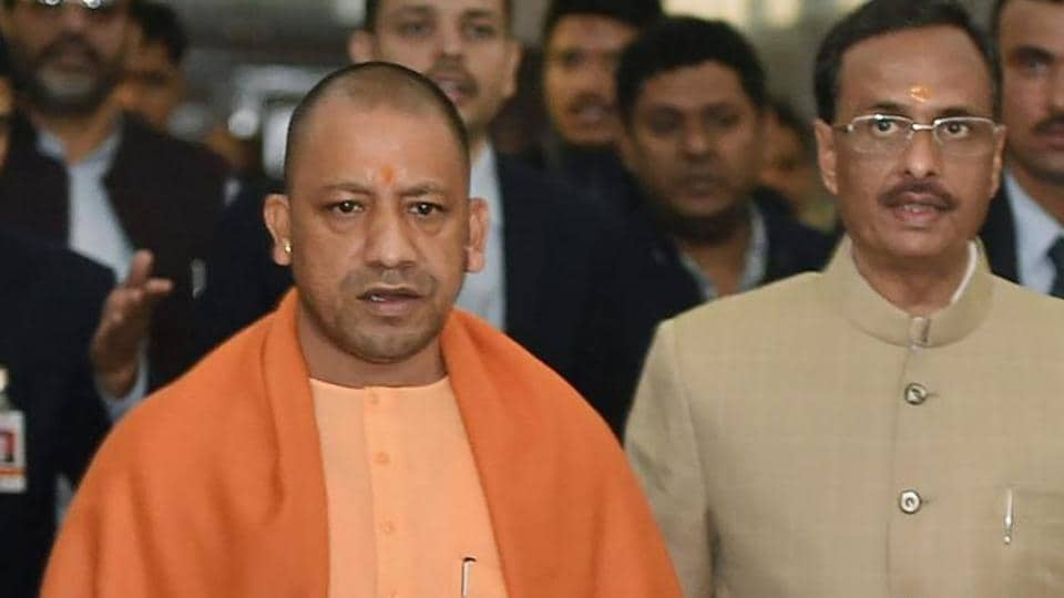 Uttar Pradesh CM Yogi Adityanath with his deputy Dinesh Sharma. A senior official said CMAdityanath Adityanath had instructed that his government will not allow corrupt or non-performing officials to remain in service as they are a liability.