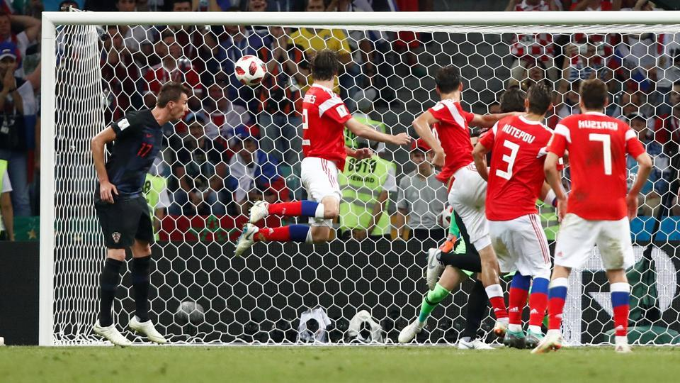 Russia's Mario Fernandes scores their second goal.  (REUTERS)