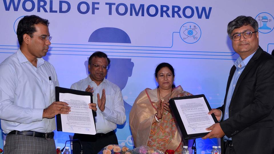 Officials display the MoU signed for digital literacy, in Jaipur on Monday.