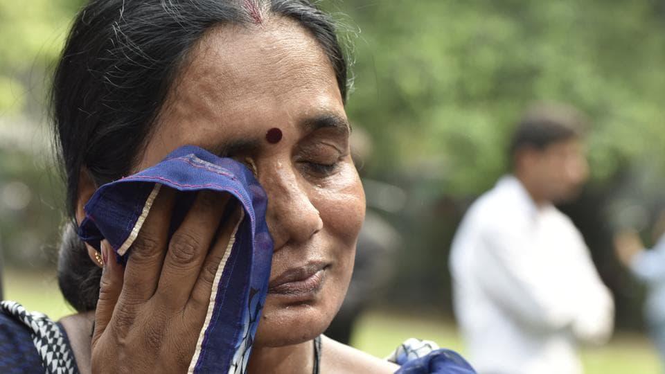 Mother of the 23-year-old woman gangraped in Delhi on December 16, 2012,reacts to Supreme Court's verdict on the convicts plea, in New Delhi, on Monday, July 9, 2018.