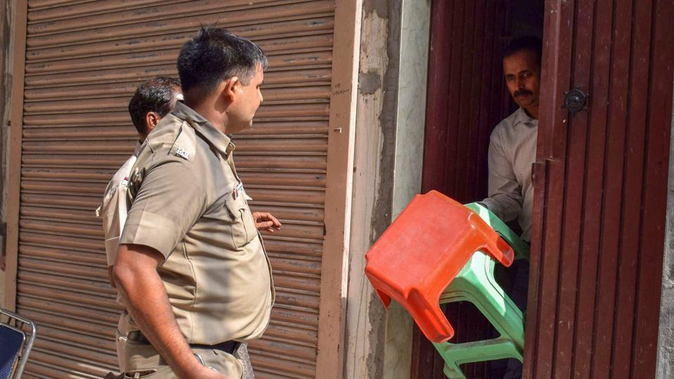 Delhi Police takes away the stools, which were supposed to be used by the Bhatia family members while committing suicide, at Burari in New Delhi on Friday.