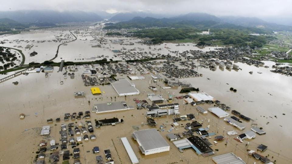 An aerial view shows submerged houses and facilities at a flooded area in Kurashiki. Days of heavy rainfall that weather officials have called historic set off flooding and landslides in western Japan, including Hiroshima, Okayama and Ehime prefectures. Many people started to return and check on their homes and begin cleanup after the rain stopped Monday. (Kyodo via REUTERS)
